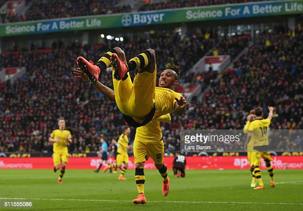 PierreEmerick Aubameyang of Borussia Dortmund celebrates as he scores their first goal during the Bundesliga match between Bayer Leverkusen and...