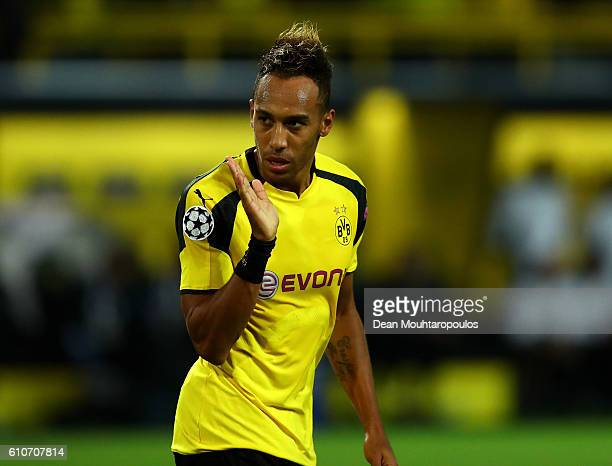 PierreEmerick Aubameyang of Borussia Dortmund celebrates as he scores their first goal during the UEFA Champions League Group F match between...