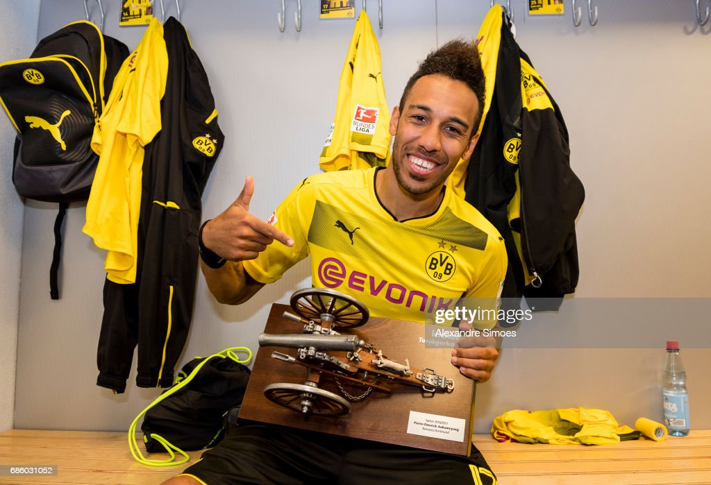 Pierre-Emerick Aubameyang of Borussia Dortmund celebrates getting the trophy for being the top scorer of this season after the final whistle during the Bundesliga match between Borussia Dortmund and Werder Bremen at Signal Iduna Park on Mai 20, 2017 in Dortmund, Germany.