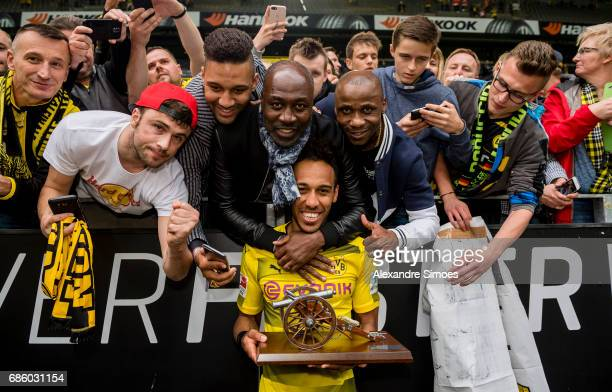 PierreEmerick Aubameyang of Borussia Dortmund celebrates getting the trophy for being the top scorer of this season with his family after the final...