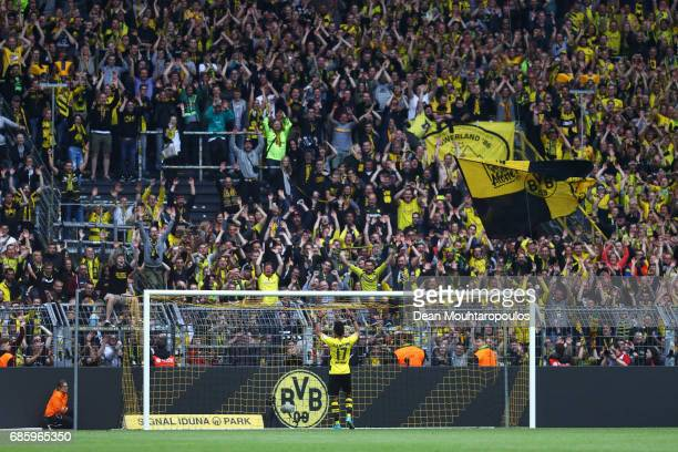 PierreEmerick Aubameyang of Borussia Dortmund celebrates in front of the Kop or home fans after victory in the Bundesliga match between Borussia...