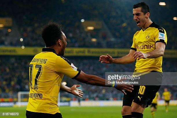 PierreEmerick Aubameyang of Borussia Dortmund celebrates scoring his team's first goal with his team mate Henrikh Mkhitaryan during the Bundesliga...