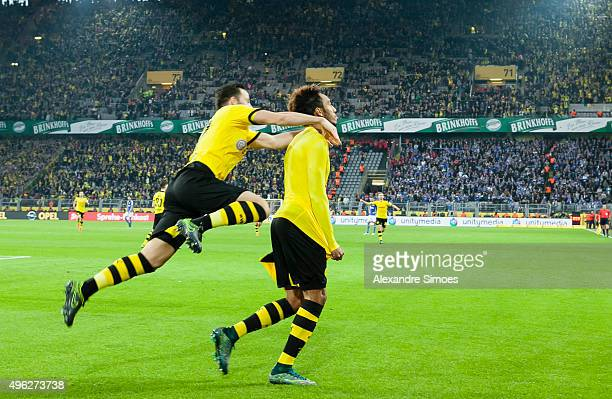 PierreEmerick Aubameyang of Borussia Dortmund celebrates scoring the goal to the 31 together with his team mate Gonzalo Castro during the Bundesliga...