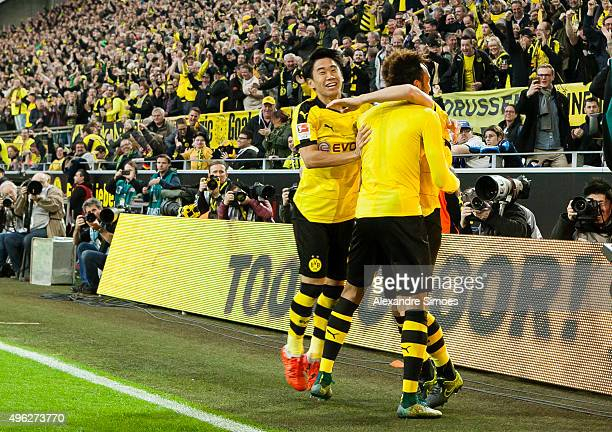 PierreEmerick Aubameyang of Borussia Dortmund celebrates scoring the goal to the 31 together with his team mates Shinji Kagawa and Gonzalo Castro...