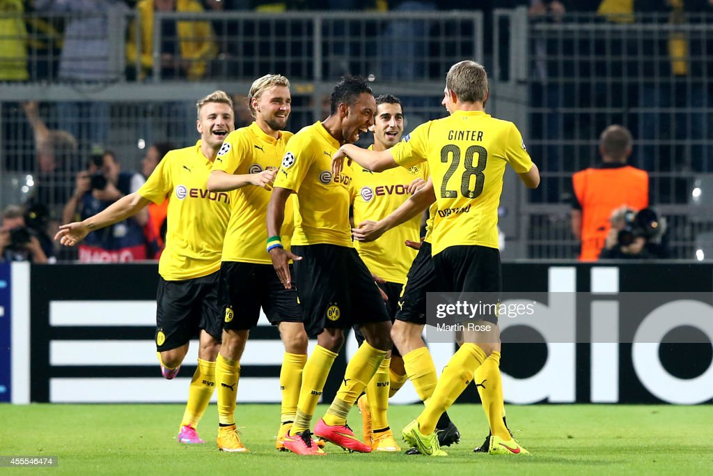 Pierre-Emerick Aubameyang (C) of Borussia Dortmund celebrates with teammates after scoring his team's second goal during the UEFA Champions League Group D match between Borussia Dortmund and Arsenal at Signal Iduna Park on September 16, 2014 in Dortmund, Germany.