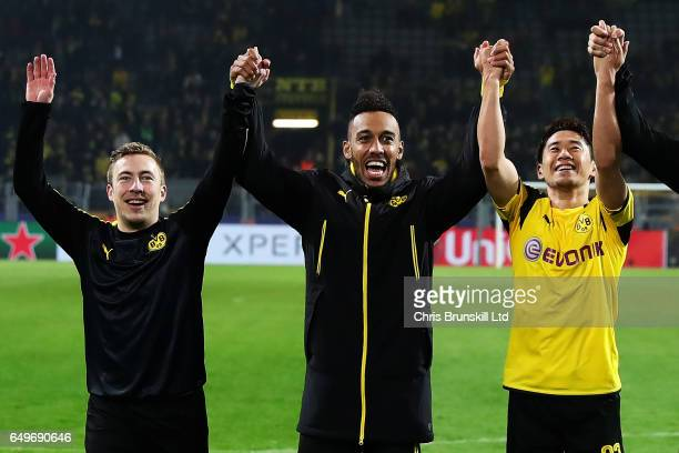 PierreEmerick Aubameyang of Borussia Dortmund celebrates with teammates Felix Passlack and Shinji Kagawa at the end of the UEFA Champions League...