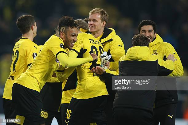 PierreEmerick Aubameyang of Borussia Dortmund celebrates with his team mates after the UEFA Europa League round of 32 first leg match between...