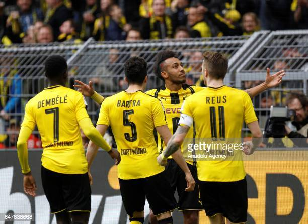 PierreEmerick Aubameyang of Borussia Dortmund celebrates with teammates Ousmane Dembele Marc Bartra and Marco Reus during the Bundesliga soccer match...