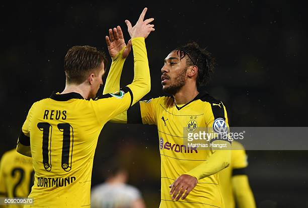 PierreEmerick Aubameyang of Borussia Dortmund celebrates with Marco Reus as he scores their second goal during the DFB Cup Quarter Final match...