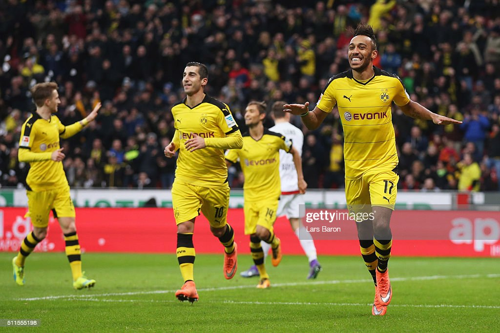 Pierre-Emerick Aubameyang of Borussia Dortmund (17) celebrates with team mates as he scores their first goal during the Bundesliga match between Bayer Leverkusen and Borussia Dortmund at BayArena on February 21, 2016 in Leverkusen, Germany.