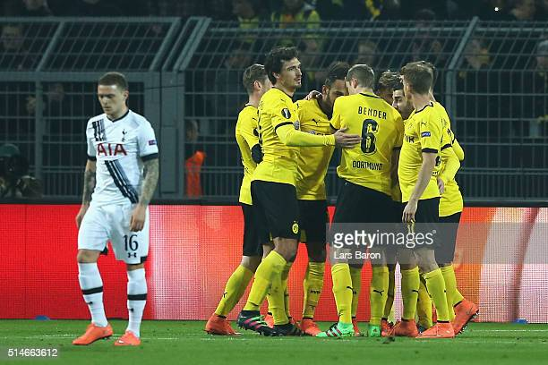 PierreEmerick Aubameyang of Borussia Dortmund celebrates with team mates as he scores their first goal during the UEFA Europa League Round of 16...