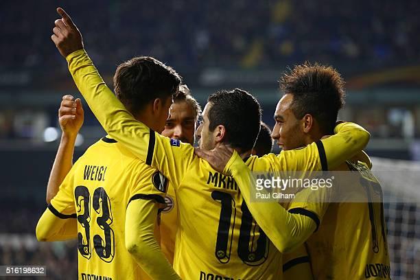 PierreEmerick Aubameyang of Borussia Dortmund celebrates with team mates as he scores their second goal during the UEFA Europa League round of 16...