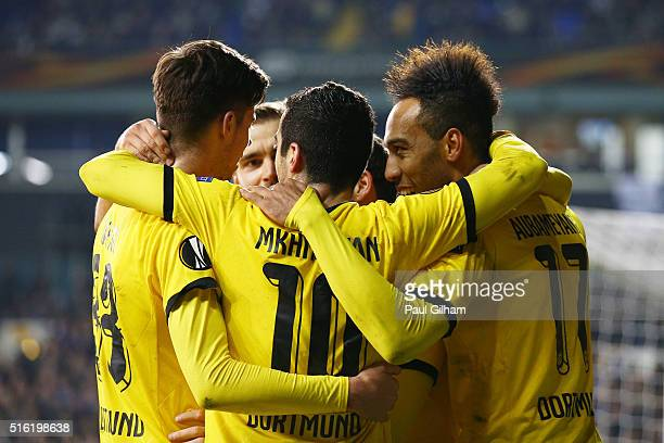 PierreEmerick Aubameyang of Borussia Dortmund celebrates with team mates as he scores their second goal during the UEFA Europa League round of 16...