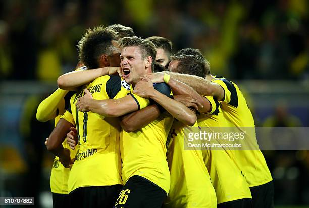 PierreEmerick Aubameyang of Borussia Dortmund celebrates with team mates as he scores their first goal during the UEFA Champions League Group F match...