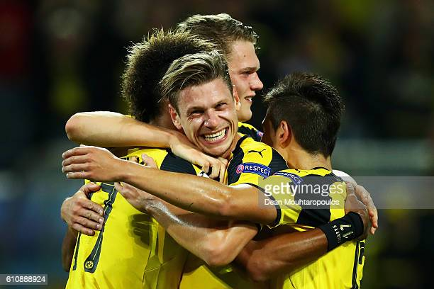 Pierre-Emerick Aubameyang of Borussia Dortmund celebrates with team mates including Lukasz Piszczek as he scores their first goal during the UEFA...