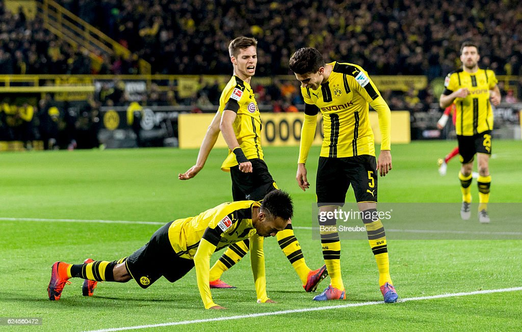 Pierre-Emerick Aubameyang of Borussia Dortmund celebrates with team mates doing press-ups after scoring his team's first goal during the Bundesliga match between Borussia Dortmund and Bayern Muenchen at Signal Iduna Park on November 19, 2016 in Dortmund, Germany.