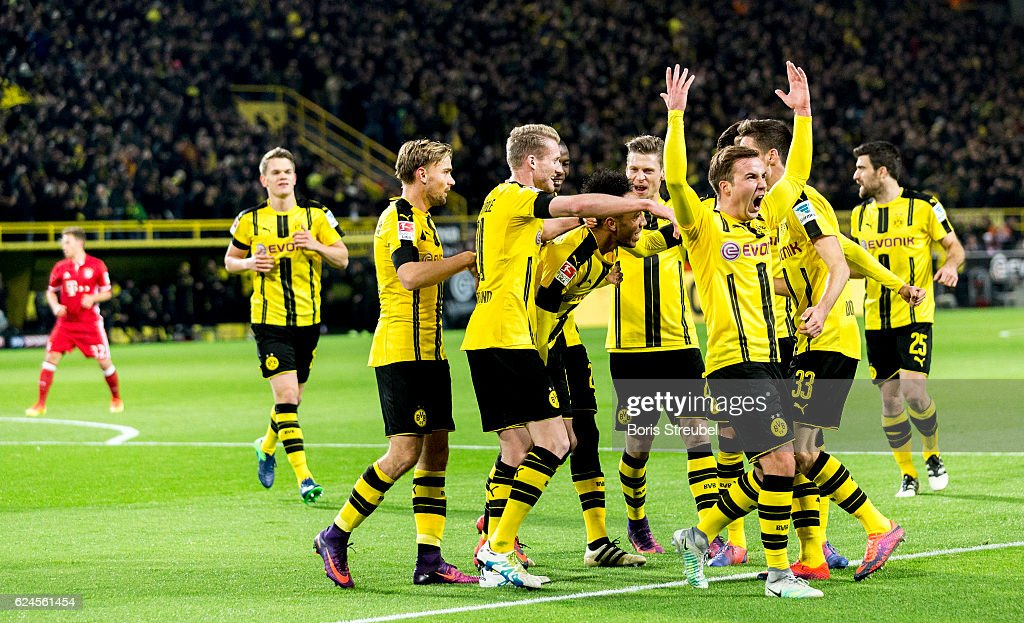 Pierre-Emerick Aubameyang (C) of Borussia Dortmund celebrates with team mates after scoring his team's first goal during the Bundesliga match between Borussia Dortmund and Bayern Muenchen at Signal Iduna Park on November 19, 2016 in Dortmund, Germany.