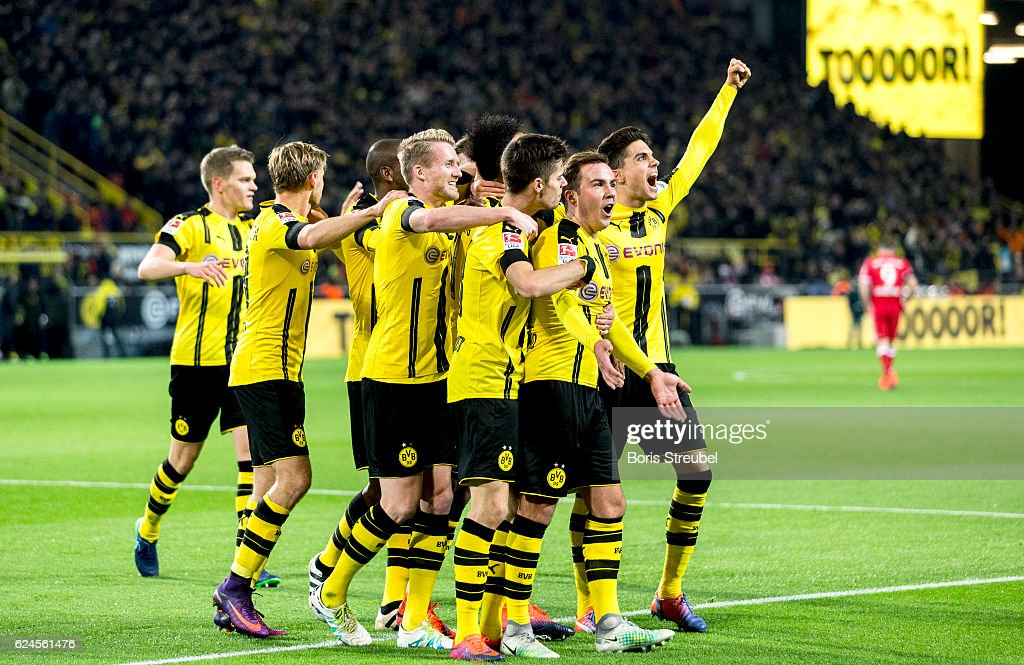 Pierre-Emerick Aubameyang of Borussia Dortmund celebrates with team mates after scoring his team's first goal during the Bundesliga match between Borussia Dortmund and Bayern Muenchen at Signal Iduna Park on November 19, 2016 in Dortmund, Germany.