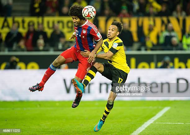 PierreEmerick Aubameyang of Borussia Dortmund challenges Dante of FC Bayern Muenchen during the Bundesliga match between Borussia Dortmund and FC...
