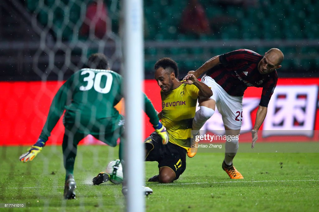 Pierre-Emerick Aubameyang of Borussia Dortmund competes for the ball with Gabriel Paletta and Marco Storari of AC Milan during the 2017 International Champions Cup football match between AC milan and Borussia Dortmund at University Town Sports Centre Stadium on July 18, 2017 in Guangzhou, China.