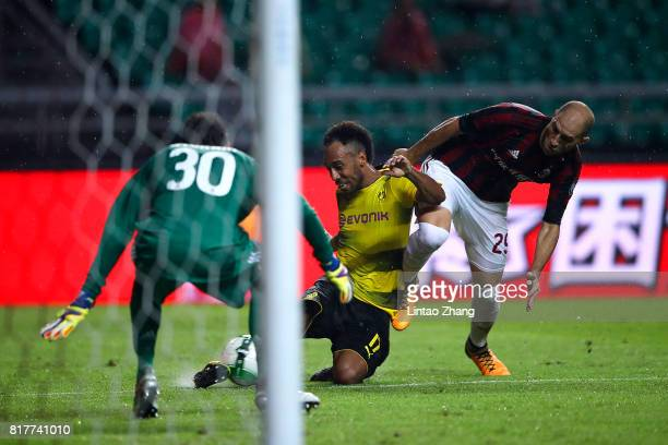 Pierre-Emerick Aubameyang of Borussia Dortmund competes for the ball with Gabriel Paletta and Marco Storari of AC Milan during the 2017 International...
