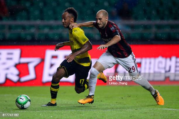PierreEmerick Aubameyang of Borussia Dortmund competes for the ball with Gabriel Paletta of AC Milan during the 2017 International Champions Cup...