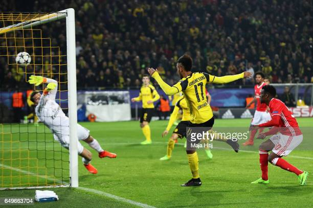 PierreEmerick Aubameyang of Borussia Dortmund headers the ball to score the first goal of the ganme during the UEFA Champions League Round of 16...