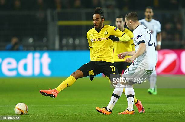 PierreEmerick Aubameyang of Borussia Dortmund is challenged by Kevin Wimmer of Tottenham Hotspur during the UEFA Europa League Round of 16 first leg...
