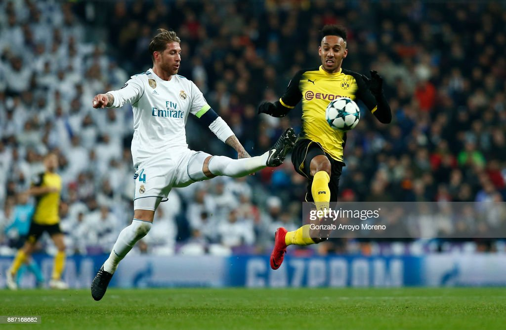 Pierre-Emerick Aubameyang of Borussia Dortmund is challenged by Sergio Ramos of Real Madrid during the UEFA Champions League group H match between Real Madrid and Borussia Dortmund at Estadio Santiago Bernabeu on December 6, 2017 in Madrid, Spain.