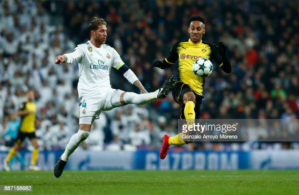 PierreEmerick Aubameyang of Borussia Dortmund is challenged by Sergio Ramos of Real Madrid during the UEFA Champions League group H match between...