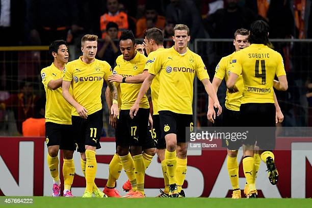 PierreEmerick Aubameyang of Borussia Dortmund is congratulated by teammates after scoring his team's second goal during UEFA Champions League Group D...