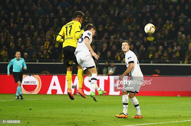 PierreEmerick Aubameyang of Borussia Dortmund outjumps Ben Davies of Tottenham Hotspur as he scores their first goal during the UEFA Europa League...