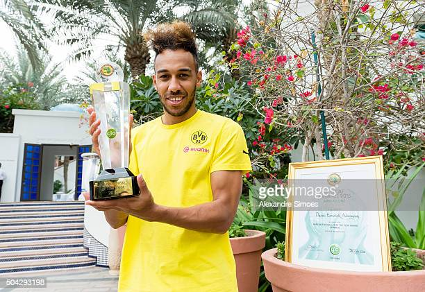 PierreEmerick Aubameyang of Borussia Dortmund poses with his African Player of the Year trophy during Borussia Dortmund's training camp on January 10...