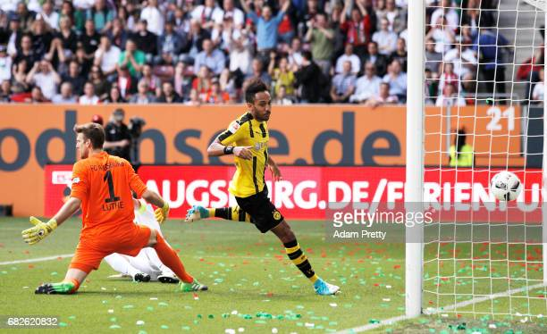 PierreEmerick Aubameyang of Borussia Dortmund scores a goal during the Bundesliga match between FC Augsburg and Borussia Dortmund at WWK Arena on May...