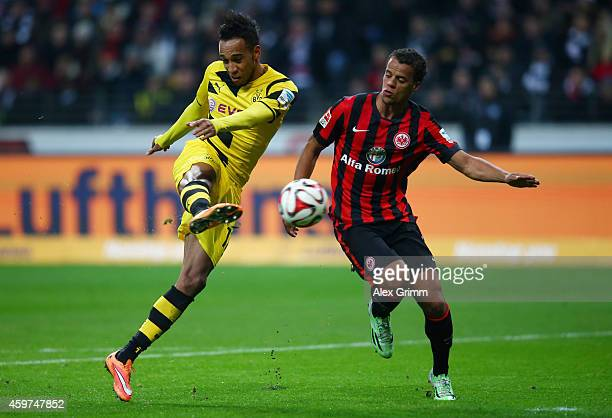 PierreEmerick Aubameyang of Borussia Dortmund takes a shot past Timothy Chandler of Eintracht Frankfurt during the Bundesliga match between Eintracht...