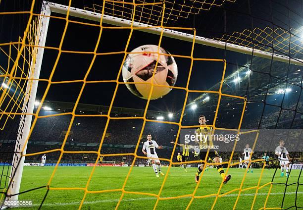PierreEmerick Aubameyang of Dortmund and Christian Pulisic of Dortmund celebrate a goal of Raphael Guerreiro of Dortmund during the Bundesliga match...