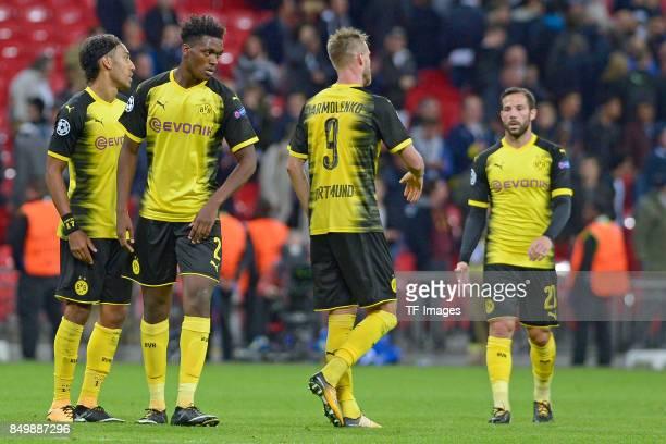 PierreEmerick Aubameyang of Dortmund and DanAxel Zagadou of Dortmund and Andrey Yarmolenko of Dortmund and Gonzalo Castro of Dortmund looks dejected...
