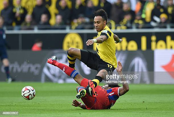 PierreEmerick Aubameyang of Dortmund and Dante of Muenchen compete for the ball during the Bundesliga match between Borussia Dortmund and FC Bayern...