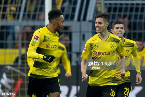PierreEmerick Aubameyang of Dortmund and Julian Weigl of Dortmund celebrates a goal with during the Bundesliga match between Borussia Dortmund and FC...