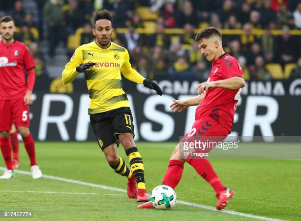 PierreEmerick Aubameyang of Dortmund and MarcOliver Kempf of Freiburg battle for the ball during the Bundesliga match between Borussia Dortmund and...