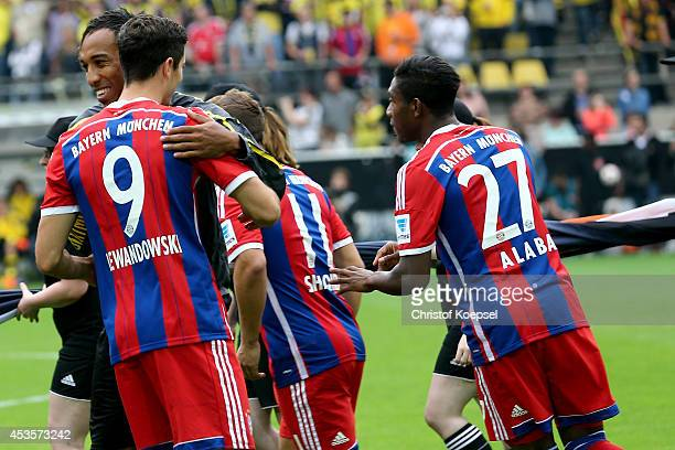 PierreEmerick Aubameyang of Dortmund and Robert Lewandowski of Bayern Muenchen embrace each other prior to the DFL Supercup match between Borussia...