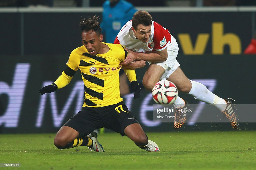 Pierre-Emerick Aubameyang of Dortmund battles for the ball with Christoph Janckern (R) of Augsburg during the Bundesliga match between Borussia Dortmund and FC Augsburg at Signal Iduna Park on February 4, 2015 in Dortmund, Germany.