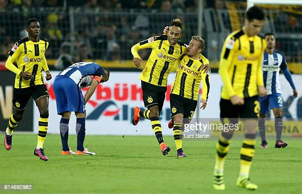 PierreEmerick Aubameyang of Dortmund celebrate with team mate Dzenis Burnic after he scores the equalizing goal during the Bundesliga match between...