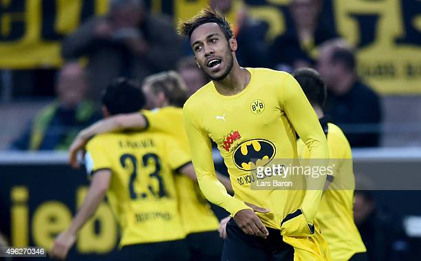 PierreEmerick Aubameyang of Dortmund celebrates after scoring his teams third goal during the Bundesliga match between Borussia Dortmund and FC...