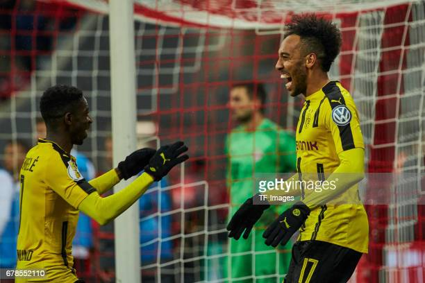 PierreEmerick Aubameyang of Dortmund celebrates after scoring his team`s second goal with Ousmane Dembele of Dortmund during the German Cup semi...