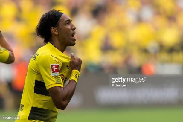PierreEmerick Aubameyang of Dortmund celebrates after scoring his team`s first goal during the Bundesliga match between Borussia Dortmund and Hertha...