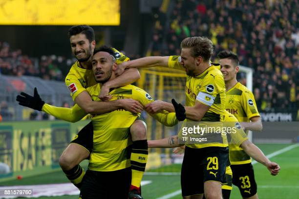 PierreEmerick Aubameyang of Dortmund celebrates after scoring his team`s first goal with team mates during the Bundesliga match between Borussia...