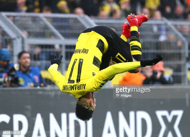PierreEmerick Aubameyang of Dortmund celebrates after scoring his team`s first goal during the Bundesliga match between Borussia Dortmund and FC...