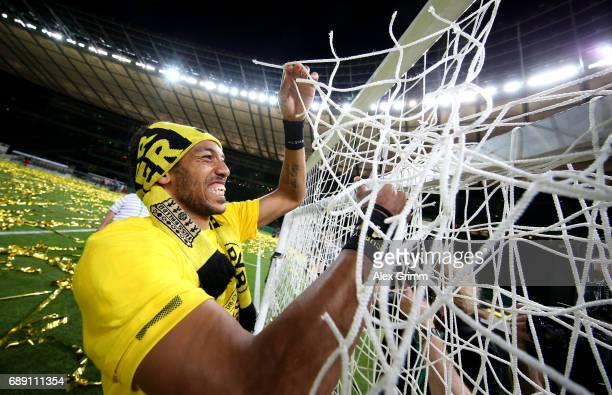PierreEmerick Aubameyang of Dortmund celebrates cutting the goal net after winning the DFB Cup final match between Eintracht Frankfurt and Borussia...