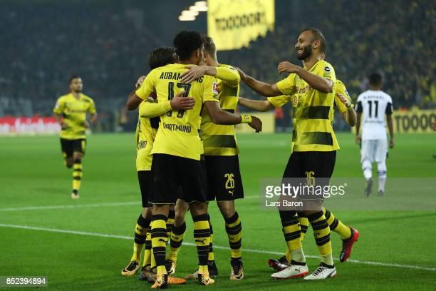 PierreEmerick Aubameyang of Dortmund celebrates his goal to make it 40 with team mates during the Bundesliga match between Borussia Dortmund and...